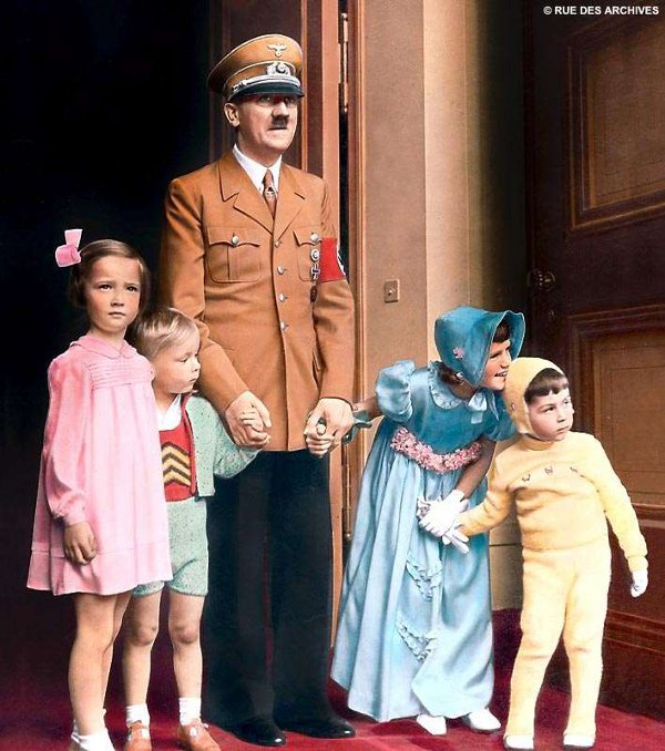 Adolf Hitler posing with clueless children