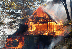 House burning in 2007 California wildfires