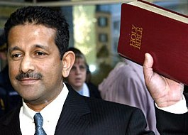 Pastor Danny Nalliah with Bible