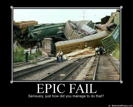 Enormous, convoluted Burlington Northern freight train wreck, captioned with 'EPIC FAIL: Seriously, just how did you manage to do that?'