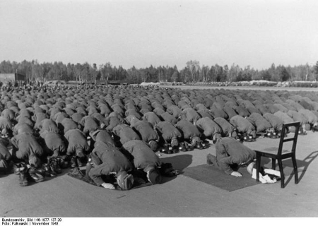 Muslim Nazi soldiers raising their posteriors in prayer