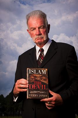 Pastor Terry Jones with book 'Islam is of the Devil'