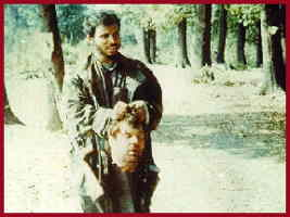 Bosnian Muslim soldier carrying severed head of Serb, Blagoje Blagojevic