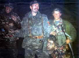 Kosovar Albanian Muslim soldiers with severed head of Serb, Bojan Cvetkovic