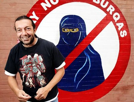 Sergio Redegalli with 'Say No to Burqa' mural