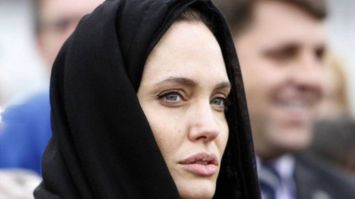 Aging actress Angelina Jolie in a hijab, complete with artificial collagen trout pout