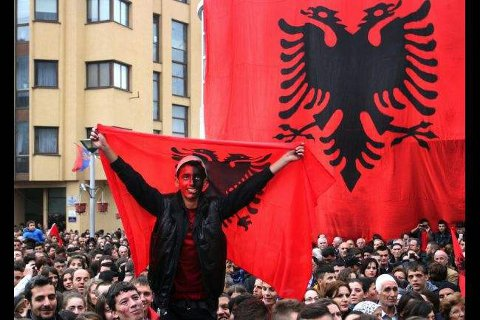 Albanian with face painted red and black