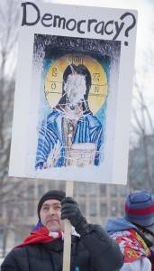Poster: 'Democracy?' with vandalized icon