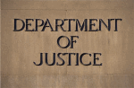 Department of Justice sign on side of building