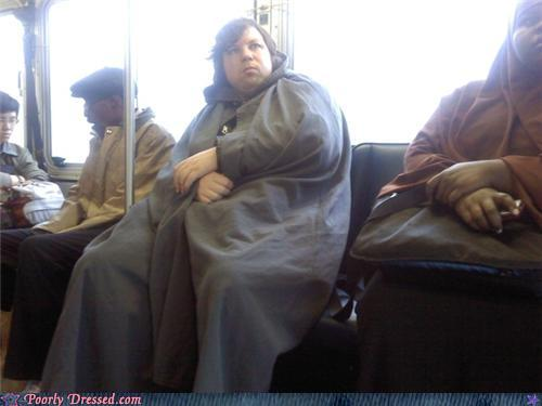 Woman on the bus in a dull, grungy cloak