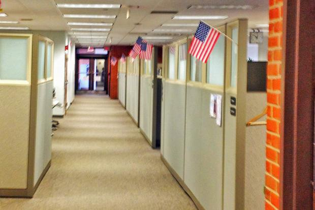 Flags of US workers being displaced by H-1b foreign workers