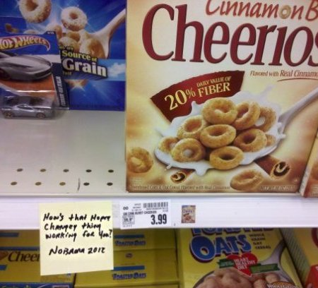 Sticky note attached to grocery shelf below Cheerios: How's that Hopey Changey thing working for you? NObama 2012