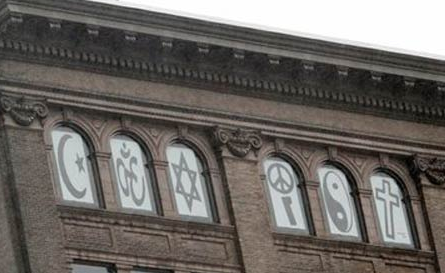 Huge 'coexist' symbol banner in the apartment windows of Russell Simmons near Ground Zero