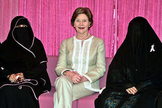 Laura Bush, uncloaked, between two heavily-veiled Saudi Arabian breast cancer survivors