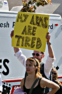 Protest sign: My arms are tired