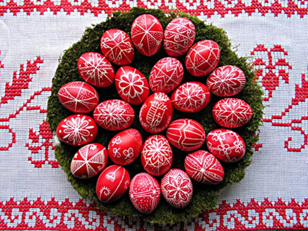 Red paschal eggs decorated in white