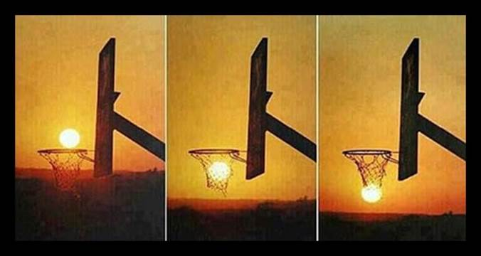 The sun appears to drop through a basketball net