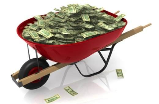 Wheelbarrow full of paper money