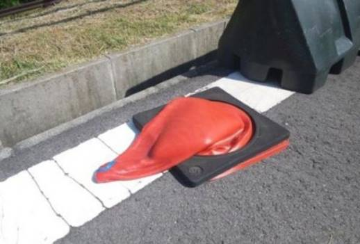 Traffic cone melts into a puddle